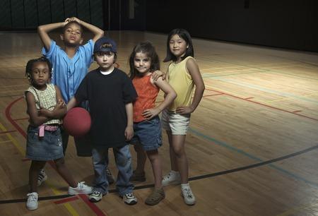 Portrait of children standing together on a basketball court Standard-Bild - 117168248