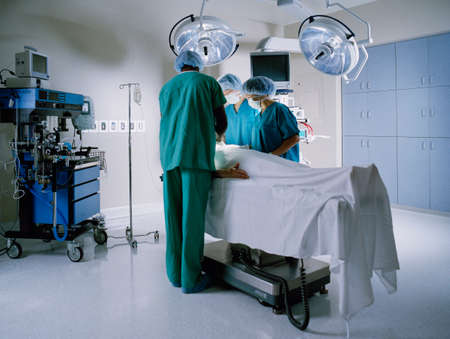 Medical professionals operating on a patient in an operation theater