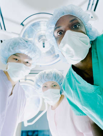 Low angle view of medical professionals in full scrubs in an operation theater