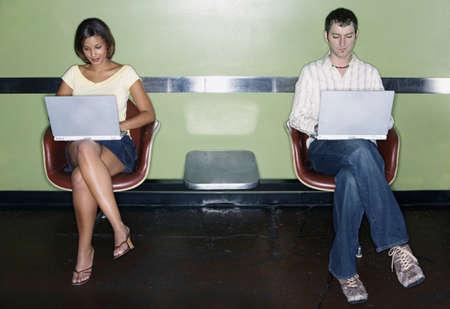 leeway: Young couple working on laptops