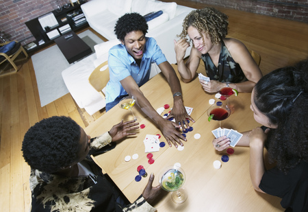 Group of people sitting at a table playing poker Banco de Imagens - 117168249