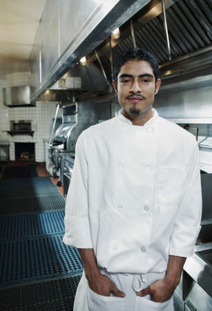 Portrait of a chef standing in a kitchen