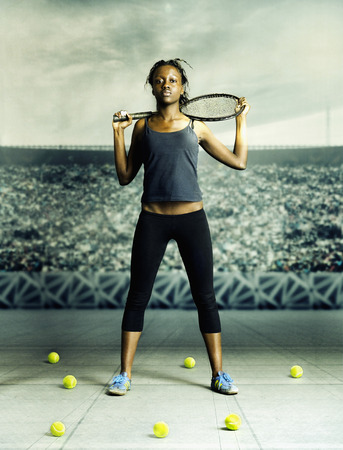 Portrait of young woman holding a tennis racket on her shoulders Stock Photo