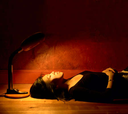 restfulness: Side profile of a young woman lying on the floor