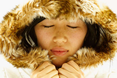 held down: Young woman wearing a hooded jacket