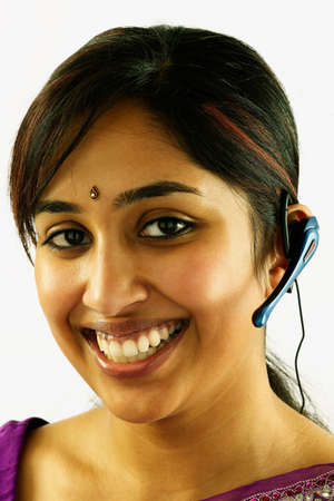 hauteur: Portrait of a woman wearing head phones smiling