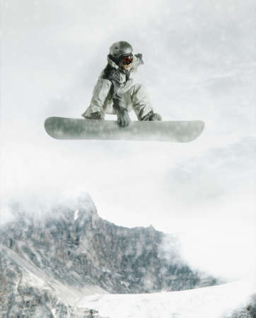 alumnae: Young male snowboarder in mid air
