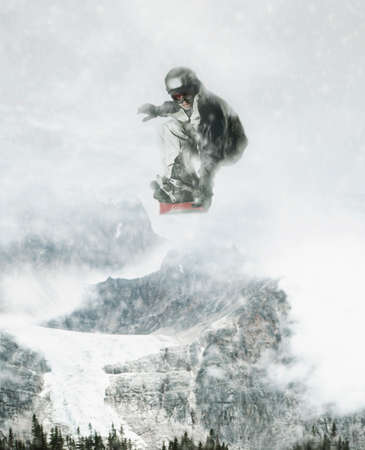 unawares: Young male snowboarder in mid air