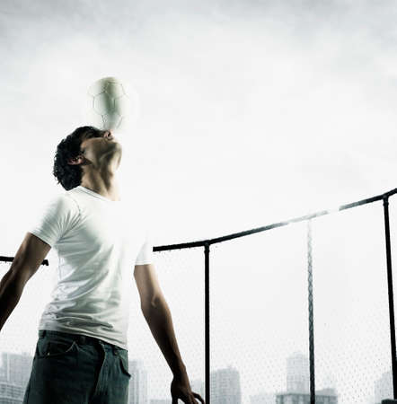 Young man balancing a bottle on his nose Stock Photo