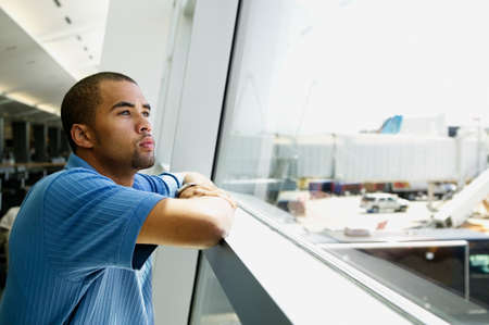 concentrates: Side profile of a young man looking out a window