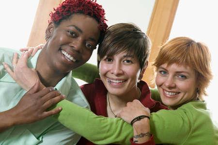 effrontery: Portrait of three young women hugging