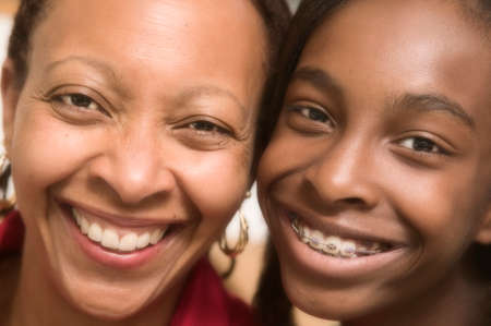 two persons only: Portrait of mid adult woman and her teenage daughter smiling