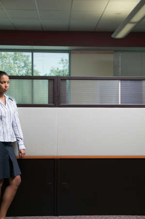 living being: Businesswoman walking in an office LANG_EVOIMAGES