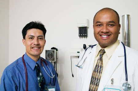 annexation: Portrait of two male doctor with stethoscopes around their necks LANG_EVOIMAGES