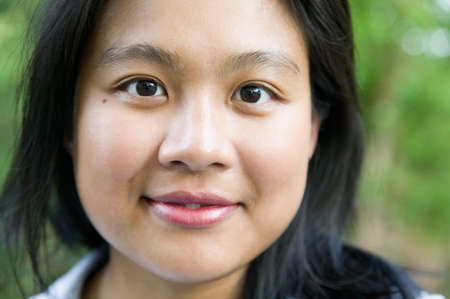 fluency: Portrait of a young woman smiling