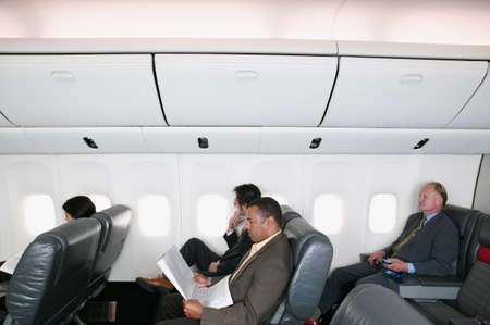living being: Businessmen traveling in an airplane