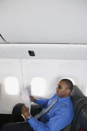 Mid adult businessman traveling in an airplane