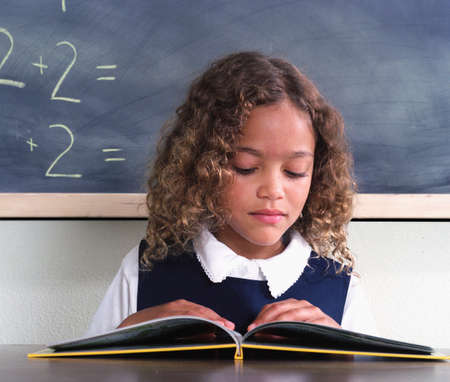 living being: Young girl sitting reading a book