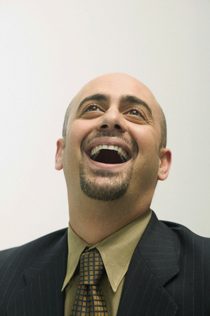 Mid adult man laughing Imagens
