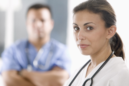 two persons only: Portrait of a female and a male medical personnel looking at camera