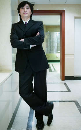 panache: Businessman standing in a corridor, Beijing , China LANG_EVOIMAGES