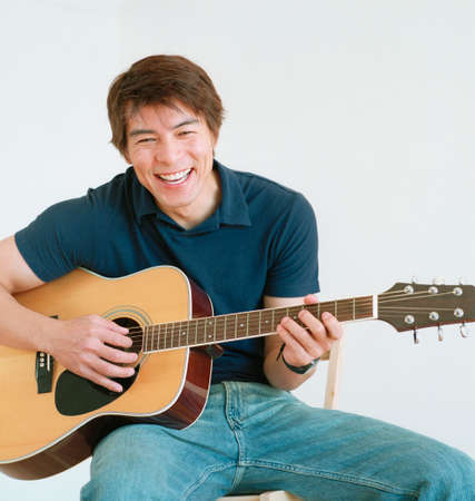 confab: Young man playing a guitar