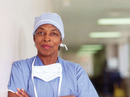 Female surgeon standing in a hospital corridor LANG_EVOIMAGES