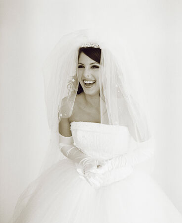 living being: Portrait of a young bride laughing LANG_EVOIMAGES