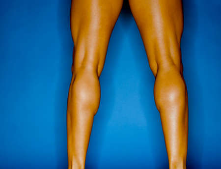 effrontery: Rear view close-up of the muscles on a young womans legs LANG_EVOIMAGES