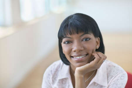 bullish: Portrait of a young woman smiling