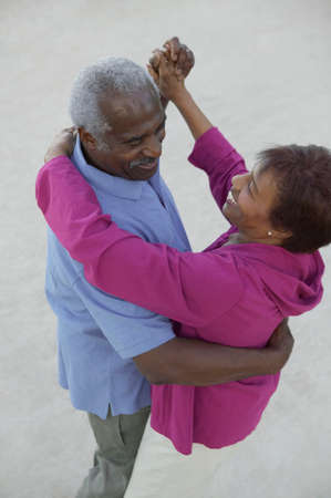 two persons only: High angle view of a mature couple dancing together