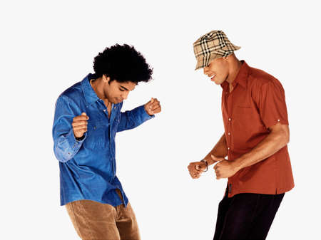 unknown age: Two young men dancing together