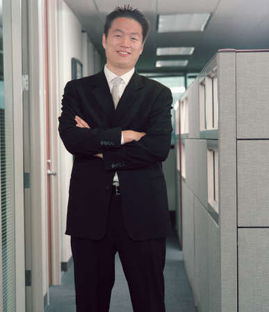 informant: Businessman standing in an office corridor