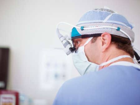 head gear: Male surgeon wearing head gear