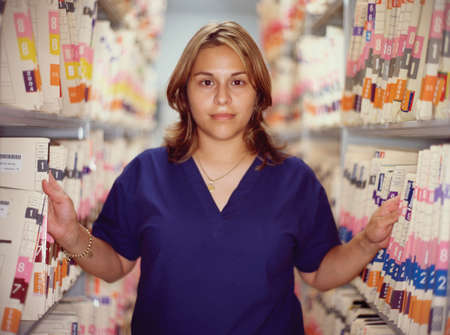 differential focus: Portrait of a female nurse standing with hospital on either side