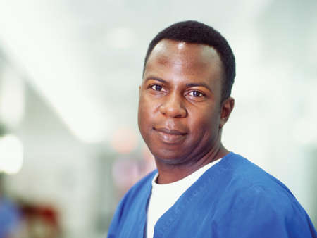 elan: Portrait of a male nurse smiling LANG_EVOIMAGES