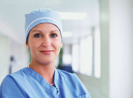 effrontery: Portrait of a female surgeon in full scrubs LANG_EVOIMAGES
