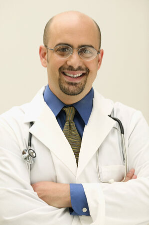 two persons only: Male doctor looking at camera smiling