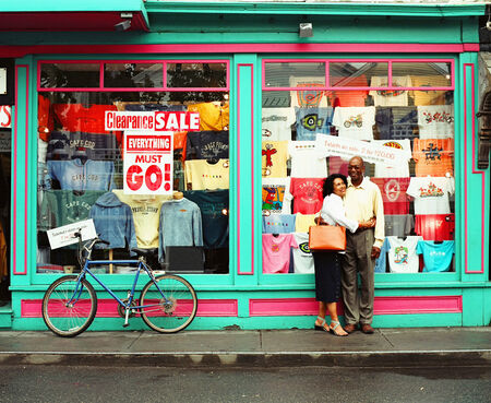 recourse: Mature couple standing in front of a clothing store