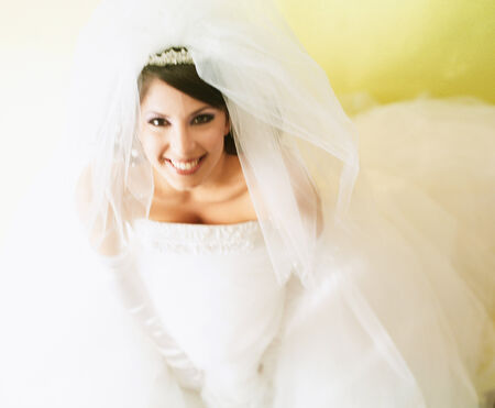 Portrait of a young woman wearing a bridal outfit smiling Stock Photo