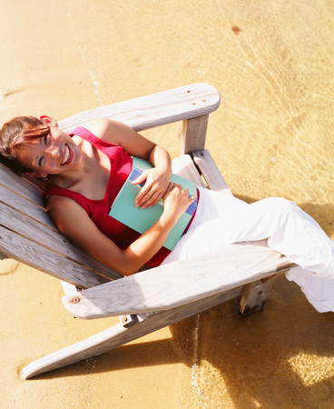informant: High angle view of a young woman sitting on a beach chair