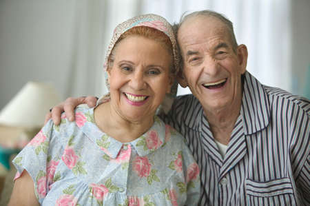 chirpy: Portrait of a senior couple holding each other smiling LANG_EVOIMAGES