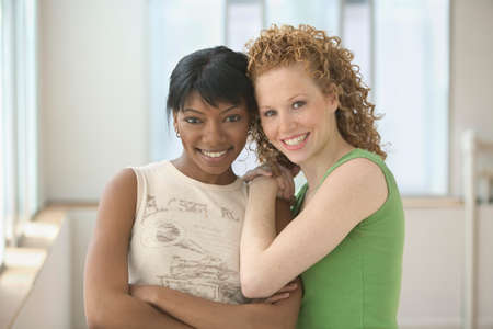 effrontery: Portrait of two young women standing together smiling