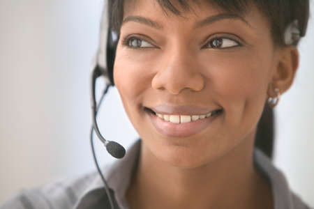 chirpy: Mid adult woman wearing a headset smiling