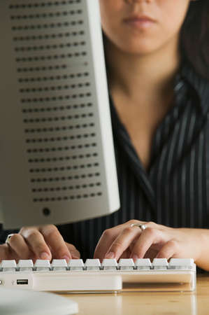 effrontery: Young woman working on a computer