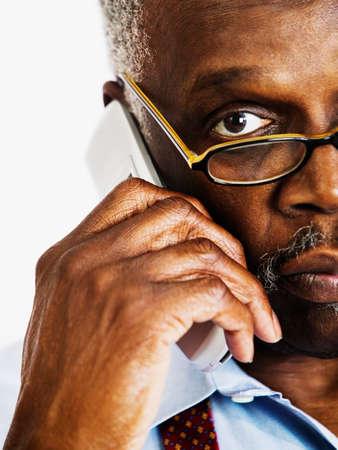 bifocals: Portrait of an elderly man talking on a mobile phone