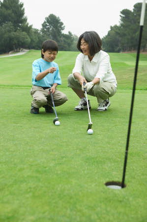 informant: Woman and a child squatting at a golf course