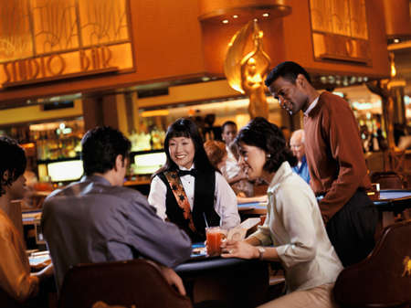 curtsy: People playing at a casino LANG_EVOIMAGES