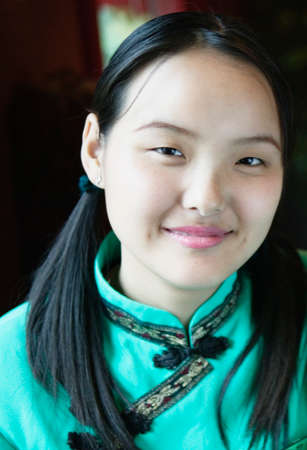 bullish: Close-up of waitress looking at camera smiling, Beijing , China