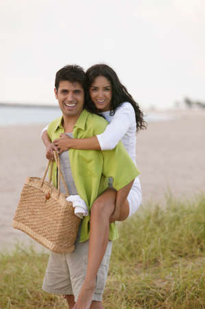 joyousness: Portrait of a woman piggyback riding on a young man